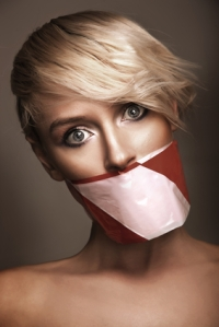 Woman's mouth sealed with a warning tape